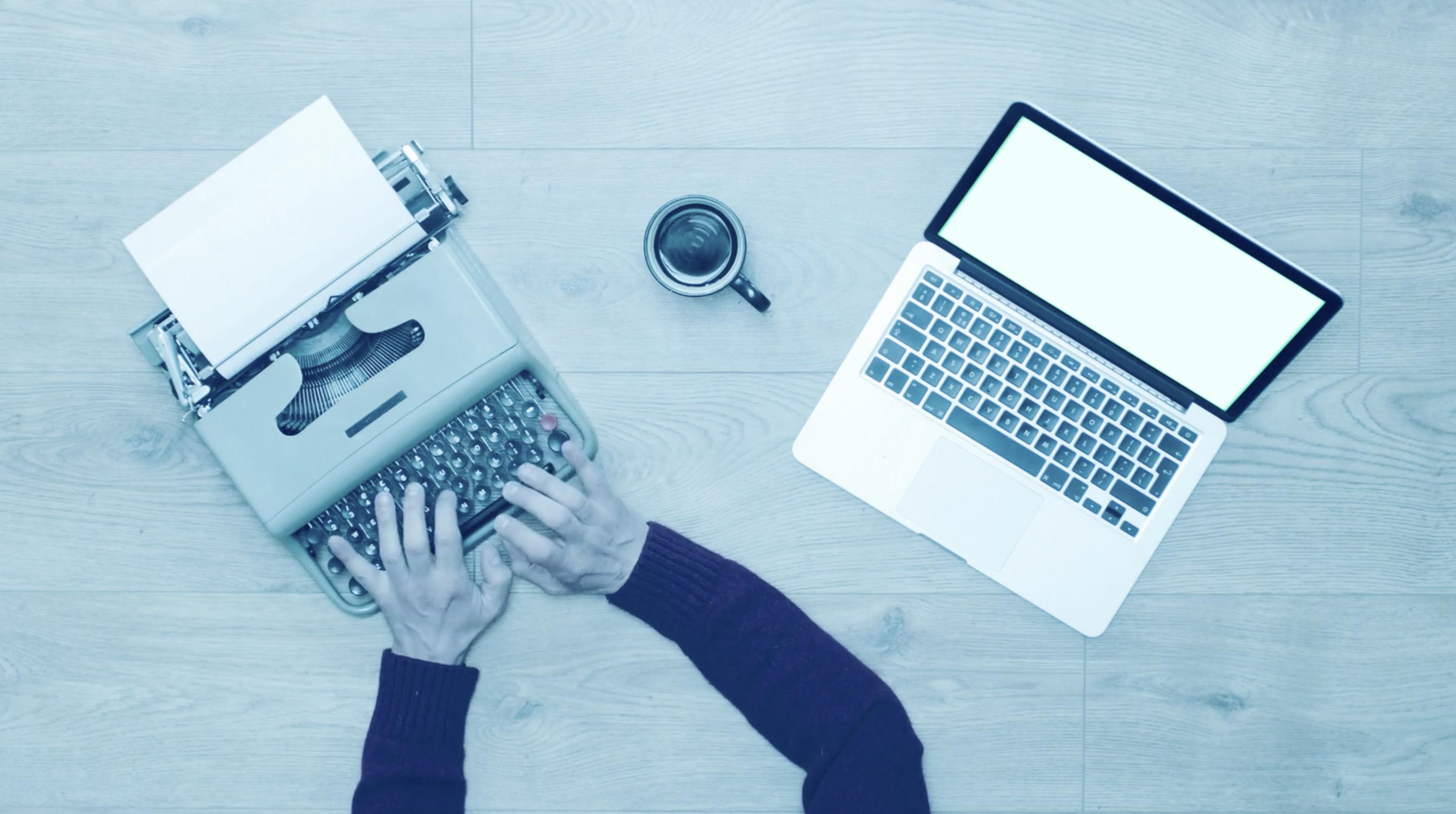 blogger hands at typewriter